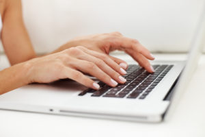 bigstock_closeup_of_female_hands_typing_21941885